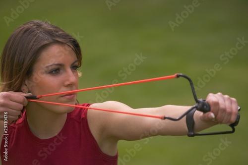 Valokuva  Woman with slingshot