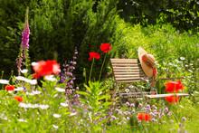 Garden Bench With Straw Hat Wi...