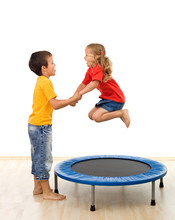 Kids Having Fun With A Trampoline In The Gym