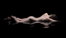 Nude Woman Lies In Water, Low Key