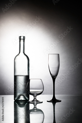 Foto op Canvas Alcohol Bottle and two glasses on table