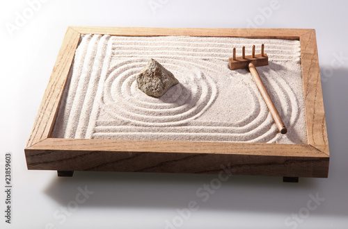 Foto auf Leinwand Zen-Steine in den Sand Mini zen garden japanese home decoration in studio