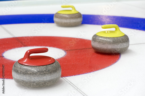 Group of curling rocks on ice Fotobehang