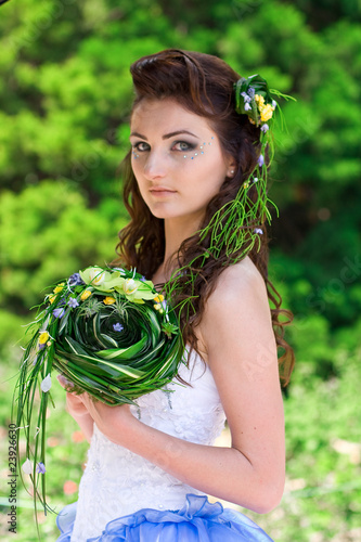 Fototapeta beautiful bride with a wedding bouquet