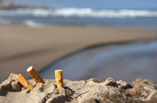 Three Cigarette Butts On Beach