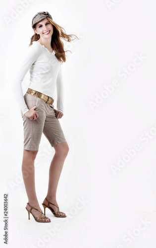 Photo  Fashionable young woman in knee length Bermuda shorts