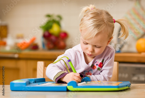 girl playing with toy computer - fototapety na wymiar