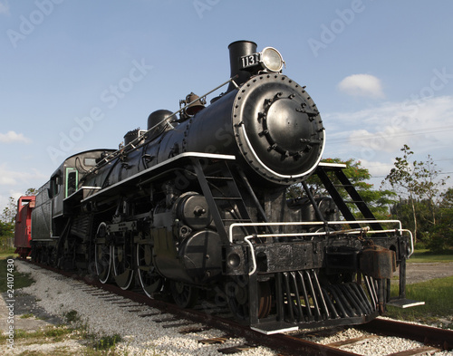 Obraz na plátně Old steam locomotive engine in a sunny Florida day