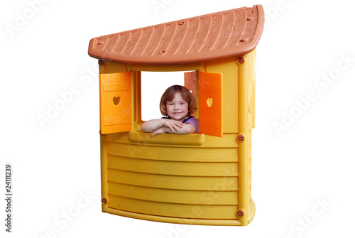 Fototapeta little girl in playhouse toy isolated