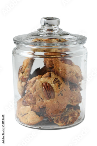 Homemade Chocolate Chip Pecan Cookies in glass cookie jar Fototapeta