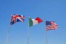 Three Flags On Blue Sky.