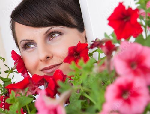 Fotografie, Obraz  Portrait of the beautiful bride among red flowers