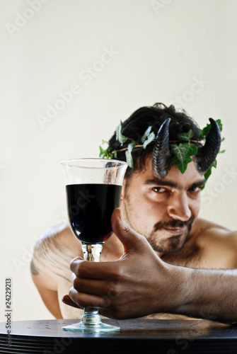 Fotografie, Obraz A satyr is offering a glass of red wine