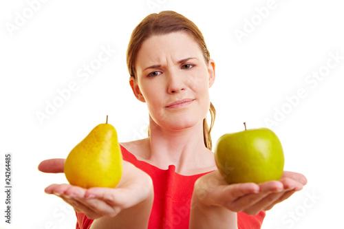Fotografie, Obraz  Vergleich zwischen Äpfeln und Birnen
