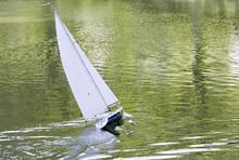 A Radio Control Toy Yacht Sailing On A Lake
