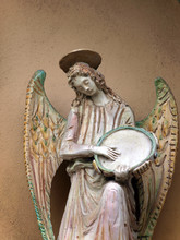 Sculpture Of An Angel With Tambourine. Chiusi , Tuscany,