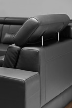 A Detail Of Black Leather Sofa