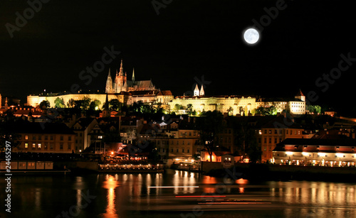 Photo Stands Full moon The night view of the beautiful Prague City