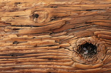 Abstract Background Texture Of Weathered Wooden Beam With A Knot