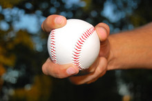 Player Gripping A New Baseball And Throws The Ball On Defense