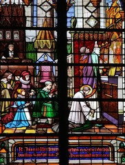 Holy Mass - stained glass church window in Mechelen, Belgium