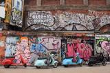 Fototapeta Młodzieżowe - Four mopeds in front of graffiti