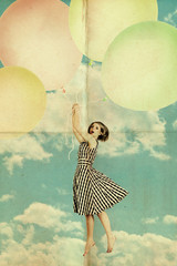 Fototapetawoman on air balls in blue sky with clouds