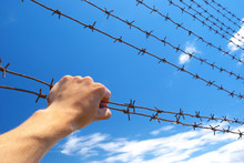 Hand Of Prison And Sky Backgro...