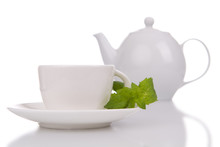 Cup Of Tea And White Teapot