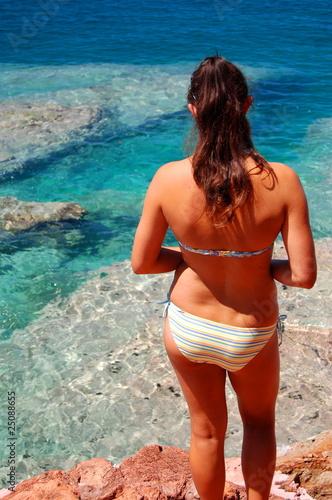Obraz Lonely girl on a beach - fototapety do salonu