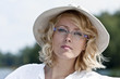 canvas print picture - the beautiful blonde in the hat and glasses
