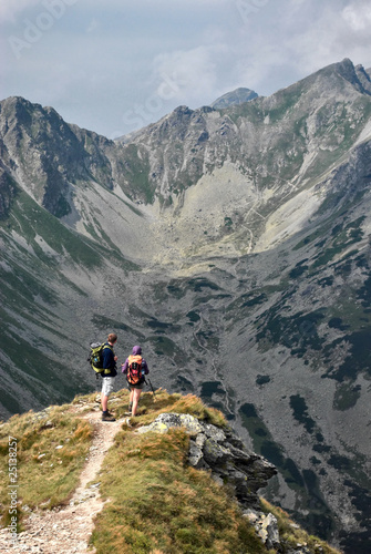 A pair of tourists admire the scenery in the Tatra Mountains