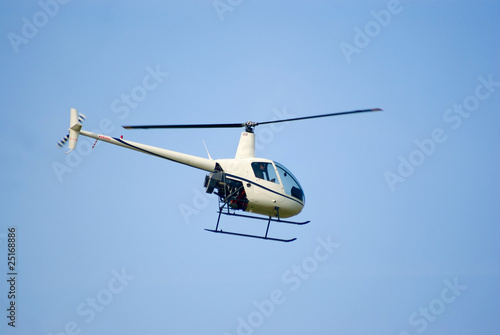 Tuinposter Helicopter Robinson R-22 helicopter in the air