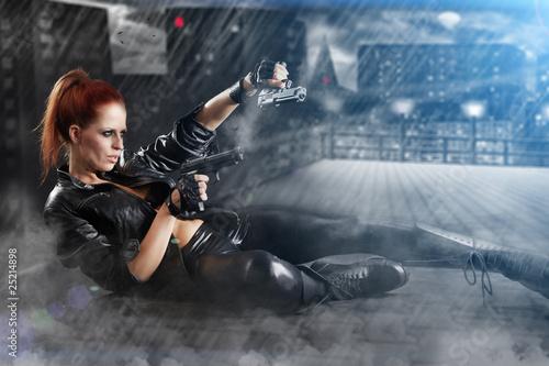 Photo  beautiful sexy girl holding gun . smoke background