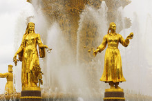 Soviet Fountain Of Friendship Of People. Statues Of Uzbek And Ge