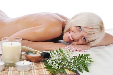 Obraz na płótnie Canvas Young woman at spa procedure