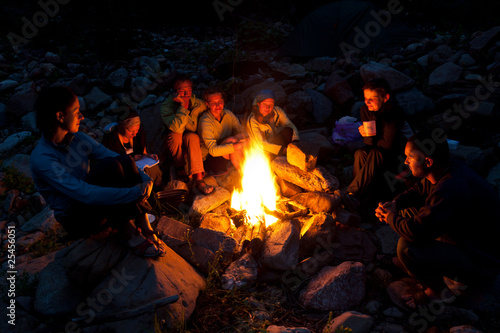 фотография People near campfire in forest.