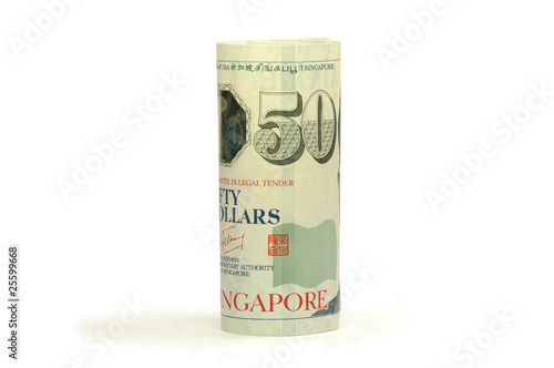 Photo  Singapore currency rolled