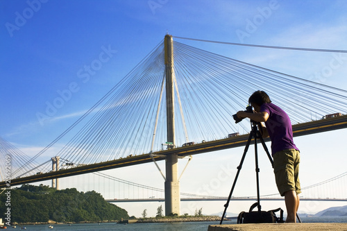 man take photo of the bridge Poster