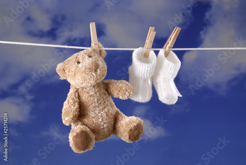 birth concept: teddy bear and baby booties #25714214