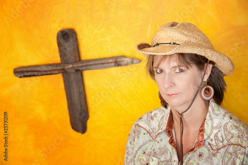 Fotografering  Woman in front of Wooden Cross
