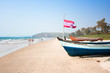 Wooden outrigger fishing boat with flag