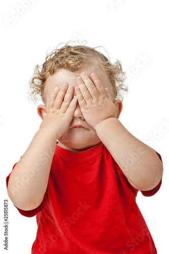 Fényképezés  Baby covering eyes with hands playing peekaboo isolated on white