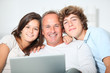 Family at home with laptop computer