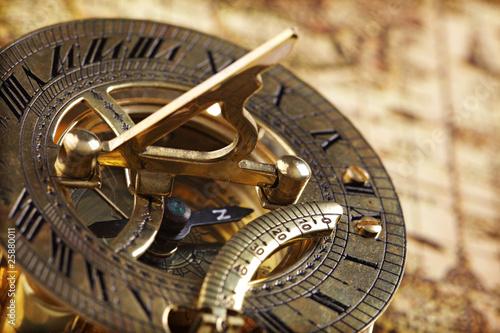 Foto op Aluminium Wereldkaart Antique brass compass and sundial