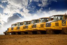 Row Of Yellow Heavy Tipper Tru...