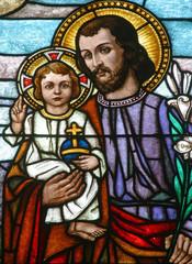 Naklejka Saint Joseph holding baby Jesus