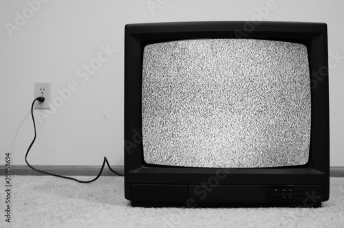Photo  Television plugged into wall with static