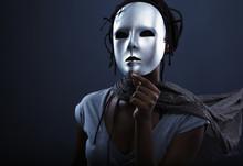 Gloomy Woman In Silver Mask Po...