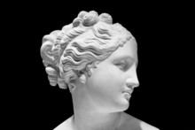 Classic White Bust Of Greek Goddess Isolated On Black